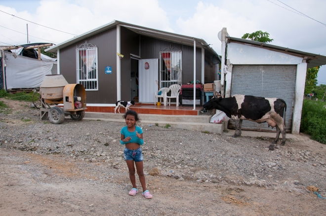 alice-a-young-girl-stands-outside-one-of-the-new-state-provided-houses